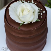 Triple Chocolate Cake With White Rose