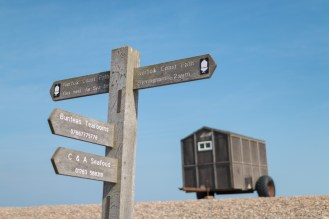 Sign post for the Norfolk Coast Path. I've never seen a signpost with phone numbers on it before!