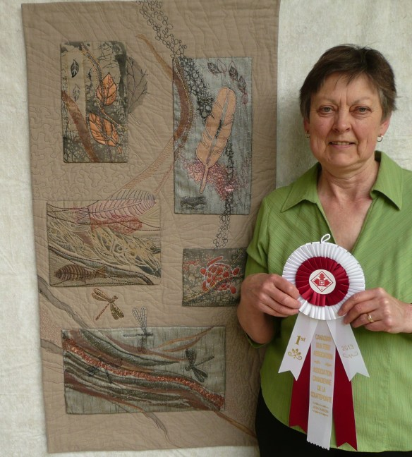 Marianne-Parsons-with-her-quilt-Set-in-Stone-and-her-first-prize-ribbon-from-Quilt-BC-2013-