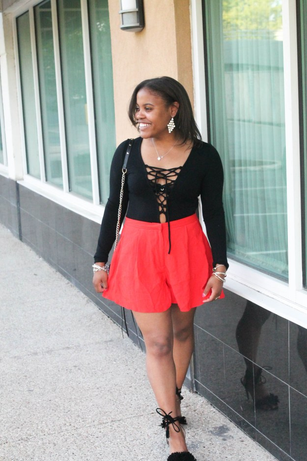 black lace up body suit red high waisted shorts going out