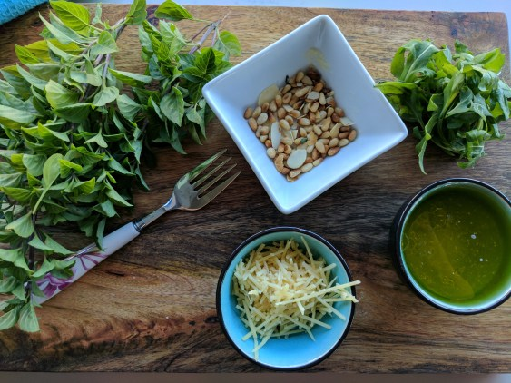 basil pesto pasta with pinenuts, rocket and parmesan
