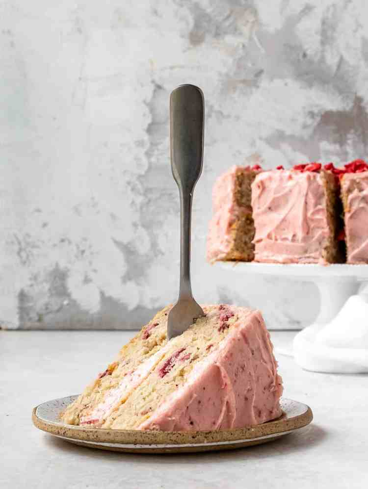 fork in a piece of  strawberry cake