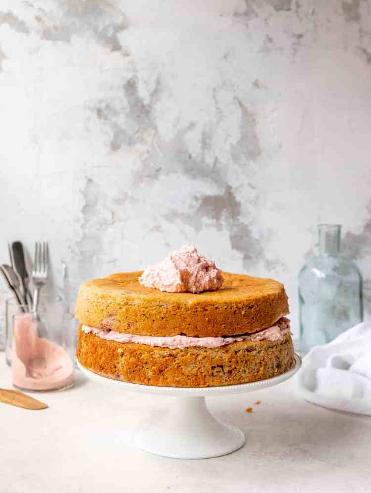 partially frosted roasted strawberry cake
