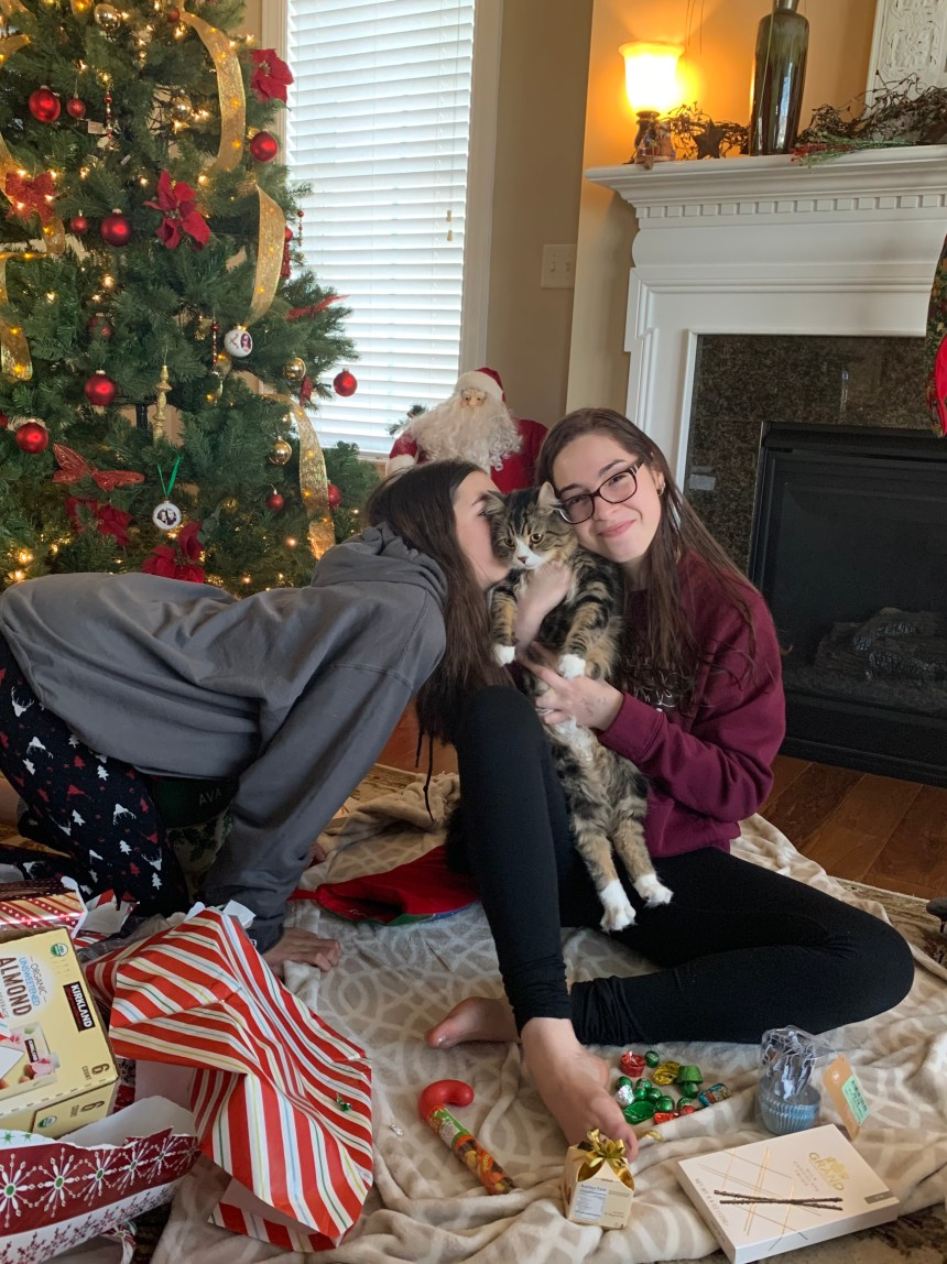 Olivia Gallucci holding cat over the holidays