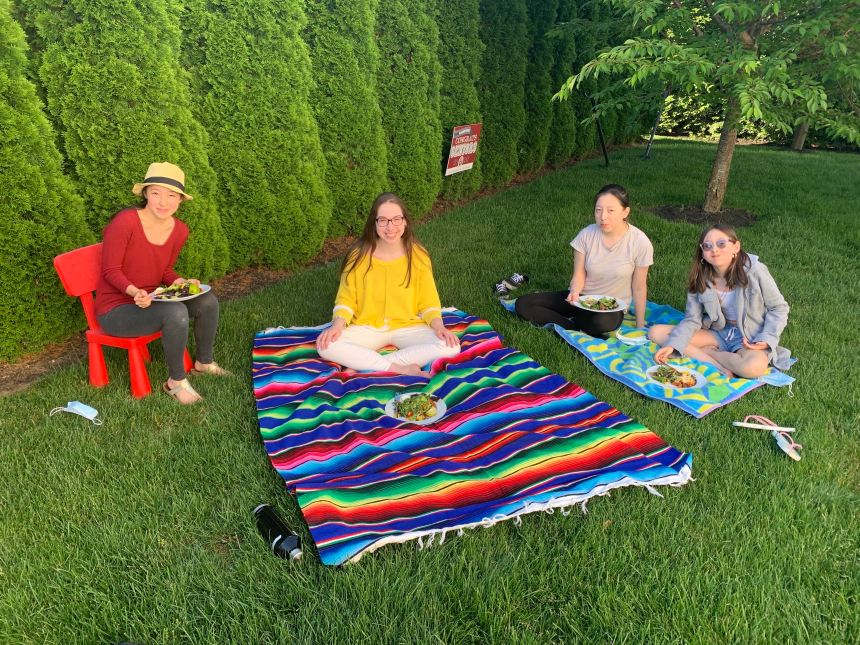 Olivia Gallucci picnicking with friends