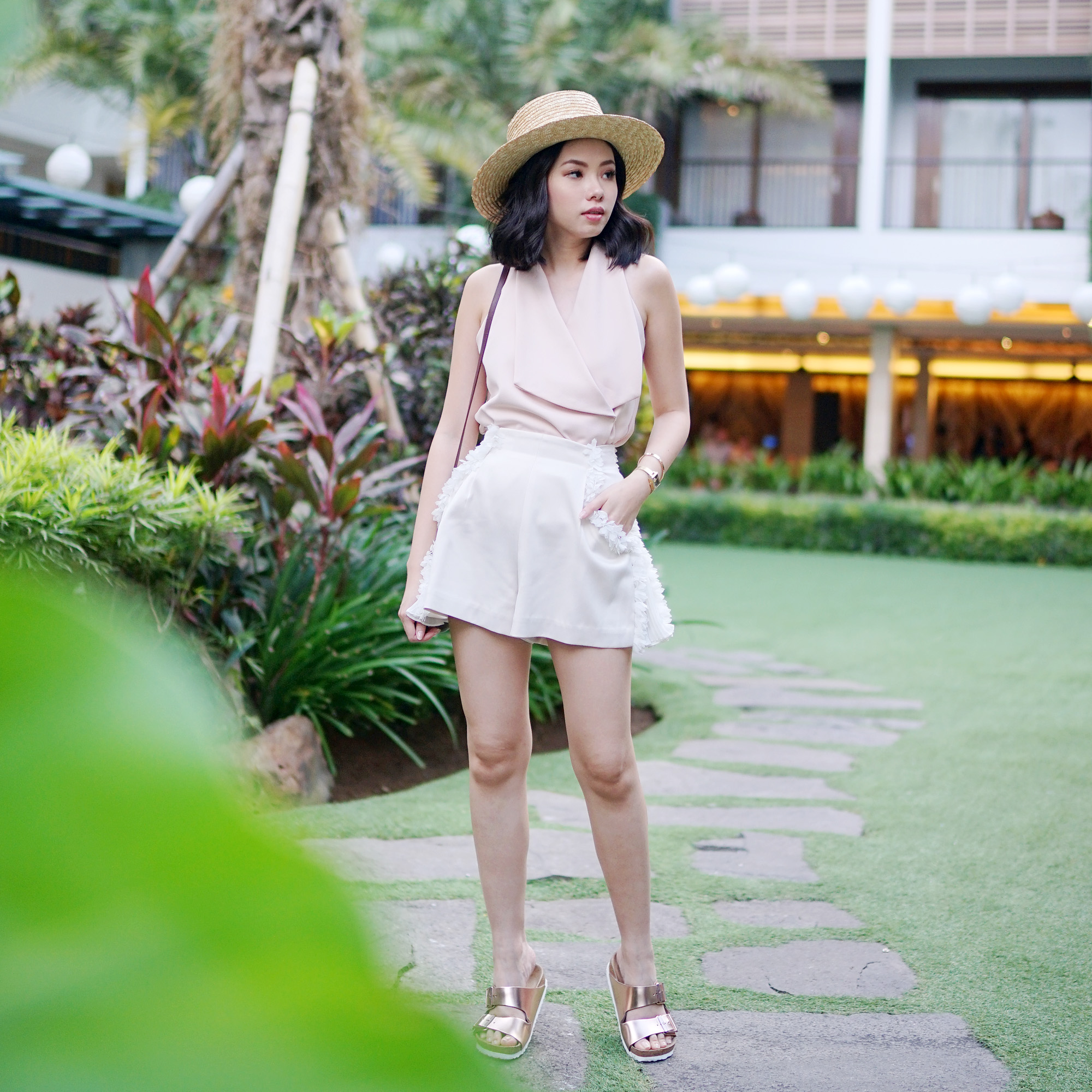 HOW TO DRESS FASHIONABLY IN TROPICAL ISLAND  WITHOUT SHOWING TOO     Sleeveless tops are decent and feminine     that is why they are so perfect  for your tropical getaway  Paired with a loose shorts  you are good to go
