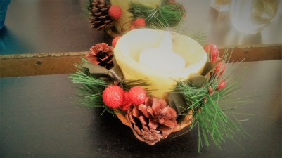 """This decoration holds a hand-made candle holder from my sister that says """"love"""" and """"peace"""" on it. You can't see that becaues of the decoration. I love this little piece."""
