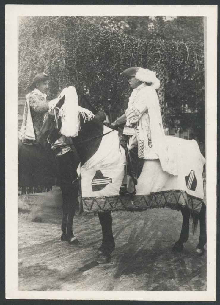 Two men in costume on horses