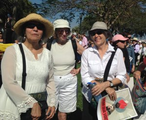 Three women at a rally in St. Petersburg, Florida