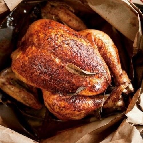 Roasted turkey in an opened paper bag