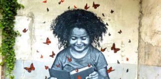 Reading on the street, graffiti Jef Aerosol.