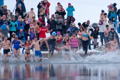 Tourism photo shoot of the annual Polar Bear Swim at Riverside Park in Kamloops