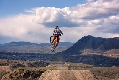 Mountain bikers reaching for the sky at The Ranch in Kamloops, BC