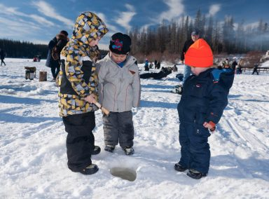 Commercial photoshoot of family ice-fishing event at Walloper Lake, BC