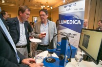 Dr. Brown explains how Lumedica has made Optical Coherence Tomography (OCT) small and affordable. OCT is the gold standard for detecting retinal eye diseases like Macular degeneration and Diabetic retinopathy. Photo by Jared Lazarus/Duke Photography