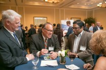 OLV Team members, Bryan Bains and Dinesh Divakaran, chat with Rob Lindberg, VP of the NC Biotechnology Center.