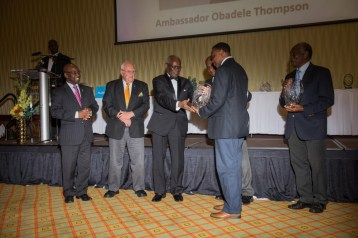 Ambassador Obadele Thompson receiving milestone award for becoming first Bajan to win individual olympic medal in 2000