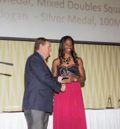 Kierre Beckles accepting her award for winning bronze in 100 M Hurdles at 2014 CAC games
