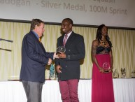 Greggmar Swift accepting his award for winning bronze in 110 M Hurdles at 2014 CAC games