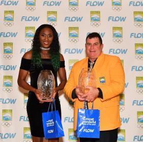 Senior Female Athlete of the Year Akela Jones and Senior Male Athlete of the Michael Maskell Jones posing with their Awards.