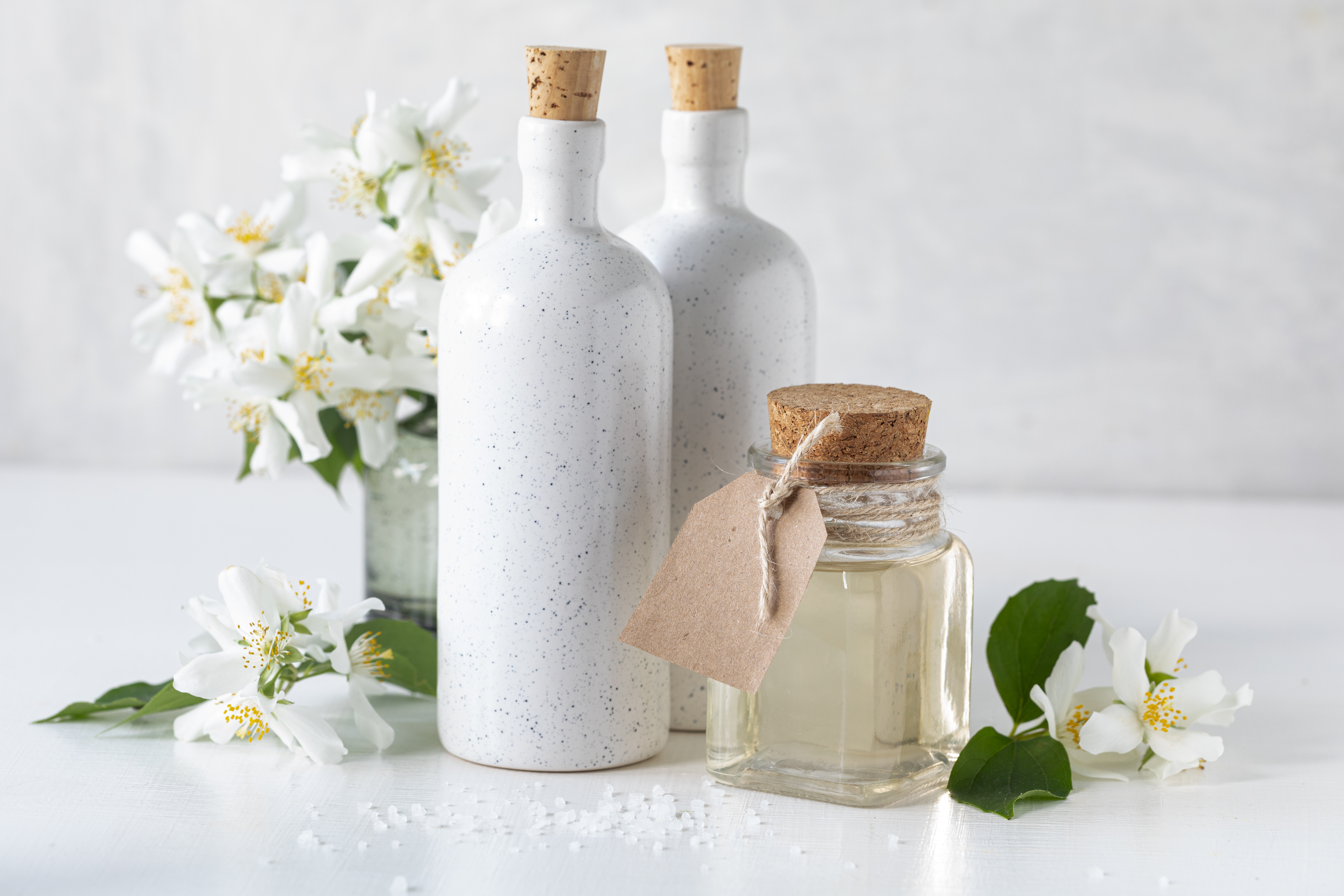 Spa concept with jasmine flowers on a white background. Copy space