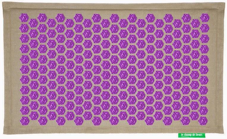 le tapis de fleurs un outil