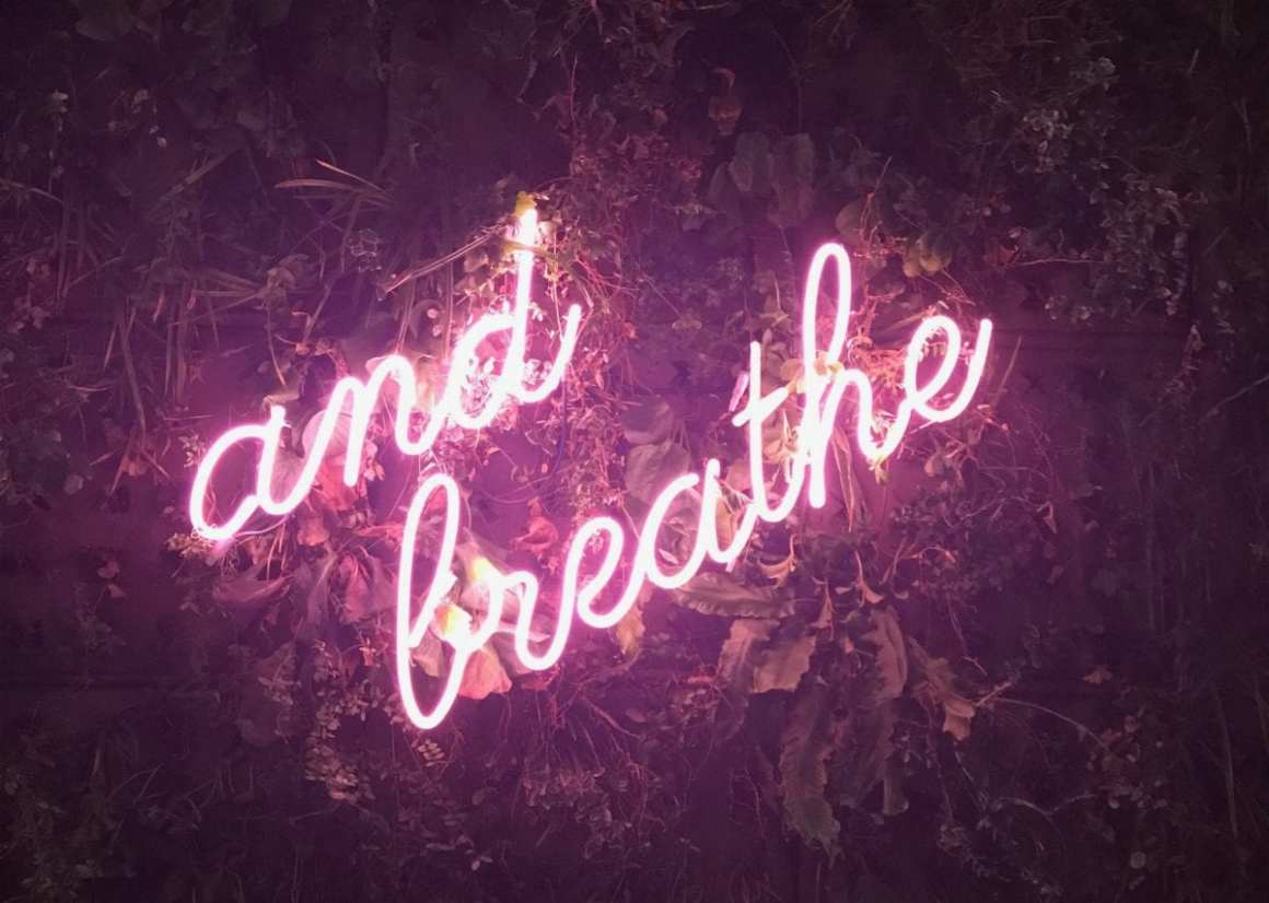 """and breathe"" sign near the entrance of the Kimpton DeWitt Amsterdam"
