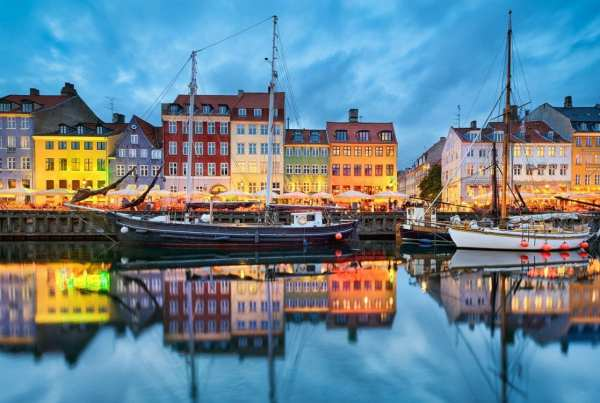 Nyhavn in Copenhagen, Denmark at night; Shutterstock