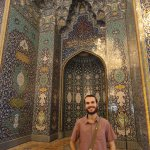In front of the mihrab.