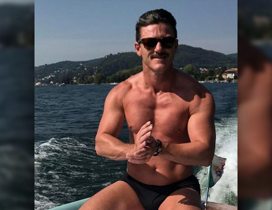 Luke Evans and Victor Turpin show off shirtless on beach vacation