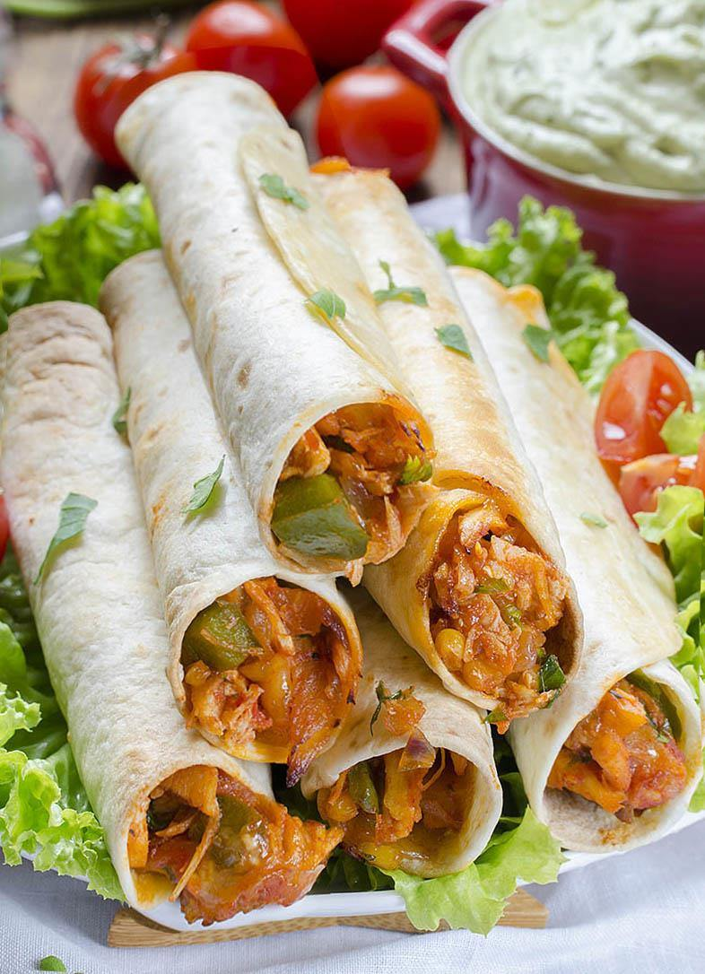 Easy Chicken Taquitos Recipe is perfect weeknight dinner. Chicken and vegetables with easy Avocado Dip are quick and healthy meal for whole family!