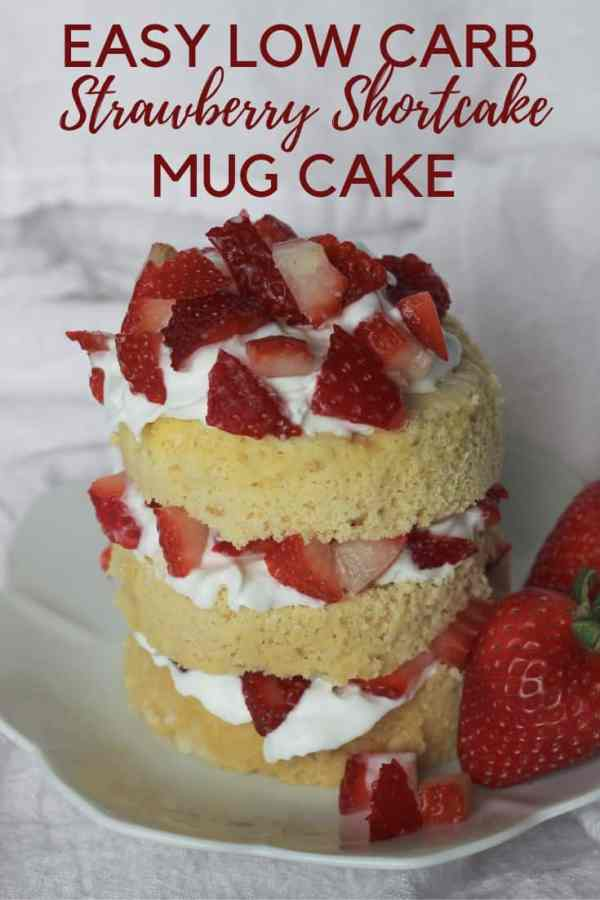 Sliced Strawberries sitting on top of a Vanilla Mug cake with dairy free whipped cream.