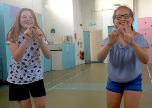 Honey and Evie creating a comedy piece as part of their bronze Arts Award