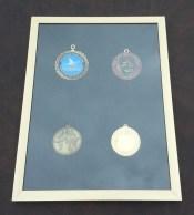 four medals, medals,frame