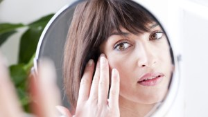 Woman Looking At Herself In The Mirror; Shutterstock ID 66637117; PO: today.com
