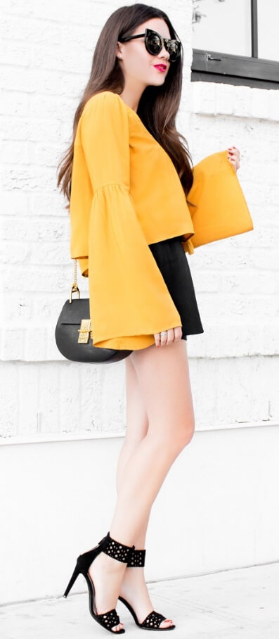 Elegant brunette in yellow bell sleeve blouse