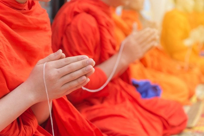 Buddhist Monks Chanting Or Praying In Temple Thailand
