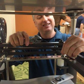 Scott Warren adjusting Artesania Audio's Exoteryc equipment rack at RMAF 2015