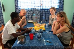 Georges, Jan, Jeanette and Camilla at the breakfast table: fresh fruit, bread, cheese and citronella infusion.