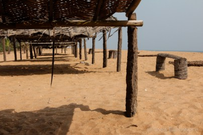 The shelters along the beach are used by fishermen and foreign visitors alike.