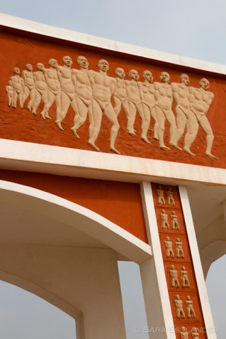 The murals on the Door show slaves moving towards the water in chains.
