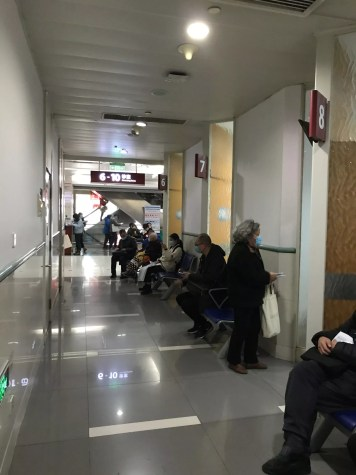 People waiting near the examination rooms in a Chinese public hospital. onaroadtonowhere.com