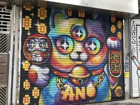 fortune cat graffiti - how to save money for travel a working class guide - onaroadtonowhere.com