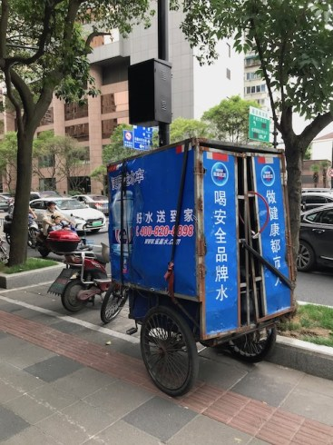 A water delivery bicycle in Shanghai, China.  Is the water in China safe? onaroadtonowhere.com