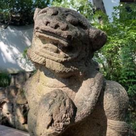 Chinese lion statue in Qiuxia Garden - onaroadtonowhere.com