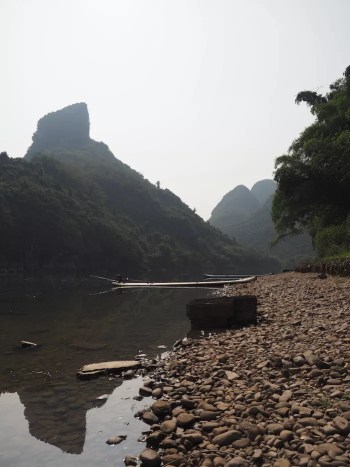 A boat by the river in Yangshuo, China - onaroadtonowhere.com