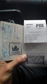 Passeport, tampon et fiche d'immigration