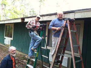 Frank, Rich and Tony working on replacement of fascia boards on a residence hall.