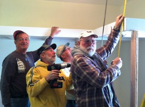 Don, Mike (another volunteer), Ross and Stan take a photo-op break while installing the loft bunks.