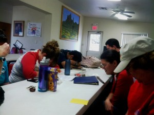 Staff and volunteers pray for the up-coming week-end and all the events and kids.